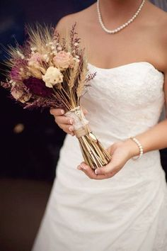rustic burgundy nad pink fall wedding bouquet ideas with wheat. Recreate this fall bouquet look with dried flowers and wheat from http://www.afloral.com/. #fallwedding