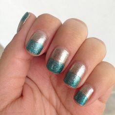 Green and gold glitter nails.