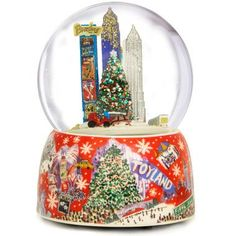 New York at Christmas Time Rotating 120mmSnow Globe   Fall in love with NYC all over again with our exquisite Christmas snow globe. The porcelain base features a lovely water color of different sc
