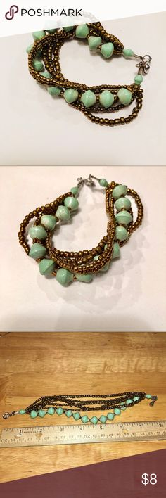 Handcrafted turquoise bracelet This handcrafted turquoise bracelet was made in Uganda, Africa. It has turquoise beads and small bronze colored beads. This measures about 8inches. Jewelry Bracelets