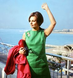 Italian actor Sophia Loren waves to her fans as she arrives at the Cannes Film Festival in 1964.
