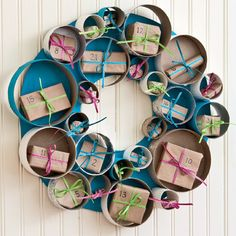 Advent wreath from cardboard tubes. Cute idea for kids' holiday party decor.