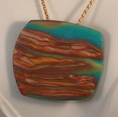 Boulder Opal in Matrix. Blue and Green translucent clay opal in a matrix of three colors of metallic clay. Transilluminates. Available by special order www.SusanDolphinDelaney.etsy.com