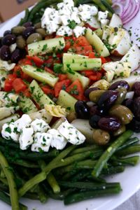 Mediterranean Vegetable Platter ~ All of the flavors that make Mediterranean cuisine so famous are found in this tasty platter of fresh vegetables: smooth buttery potatoes, briny feta, savory tart olives and more! Topped with a fresh red wine vinaigrette, there isn't much this salad doesn't offer...