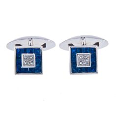 Sapphire and Diamond Cufflinks  18ct white gold sapphire and diamond square cufflinks set with square cut sapphires.  Inspired by the elegance of the 1930's, this pair of white gold square sapphire and diamond cufflinks are a new take on a classic.  A central square of 4 princess cut, rare white diamonds, with in a frame of square sapphires. Transforming the wearer into today's Charles Ryder.