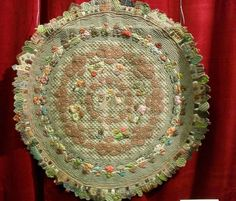 Reiko Kato round appliqué wallhanging quilt with houses and Sunbonnet Sue. Japanese / Folk style