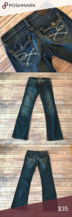 BKE Flap Pocket Stella Bootcut Jeans Size 25 These BKE Flap Pocket Stella Bootcut Jeans Size 25 do show signs of wear on the bottom hem but have much life left in them.  Detailed stitching for some pizazz.  5 pocket construction and single button and zip fly closure.  See pictures for measurements. BKE Jeans Boot Cut