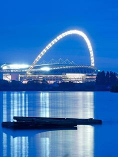With seats, Wembley Stadium is the largest covered arena in the world. Learn more about the project here. Stadium Wallpaper, Stadium Architecture, Foster Partners, Sports Stadium, London Landmarks, Wembley Stadium, Football Stadiums, Sydney Harbour Bridge, The Fosters