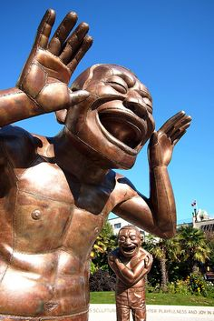 ˚A-maze-ing Laughter - The 14 patinated bronze sculptures were designed by Yue Minjun and installed in Morton Park along the English Bay in Vancouver, British Columbia, Canada.