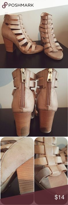 Strappy Heels Super cute and fashionable heels. Cool strappy look. In great condition- slight signs of wear (picture three). Barely any wear on bottom of shoes (picture four). Zippers open in the back. New Directions Shoes Heeled Boots