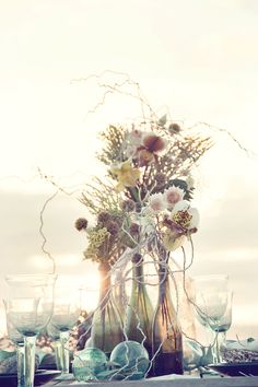 simple and pretty..beach- wine bottles with flowers.  Hopefully they'd be heavy enough to not blow over.  Audrey- I'll do my part to drink copious amounts of wine to help you stock up bottles ;) Wine Case, Dandelion, Strand, Flowers, Plants, Garden, Diy Wine Bottle, Flasks, Florals
