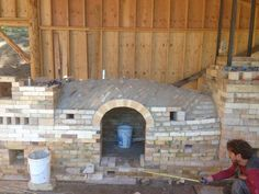 Scott Parady's wood-fired train kiln under construction, Spring 2015, CA. Note the use of the Nubian arch forming technique requiring no form.