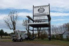 """World's Largest Rocker    The Route 66 Rocker is said to be the """"World's Largest"""" rocking chair. Standing more than 42 feet tall, it sits beside County Road ZZ (Historic Route 66) in the tiny community of Fanning, about four miles west of Cuba, Missouri."""