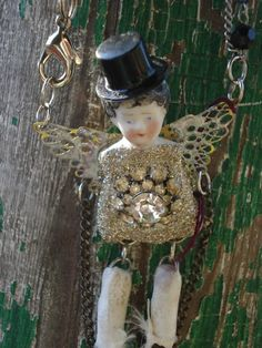 Neat use of vintage doll parts.