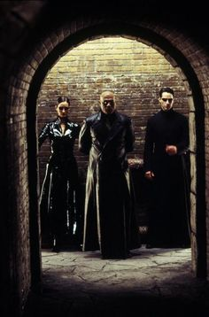Carrie-Anne Moss as Trinity, Laurence Fishburne as Morpheus, Keanu Reeves as Thomas A. Anderson/Neo in #TheMatrix