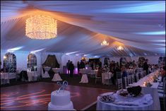 Goodwin Events built this custom drum shade chandelier for a wedding tent! About 2,000 mini lights!