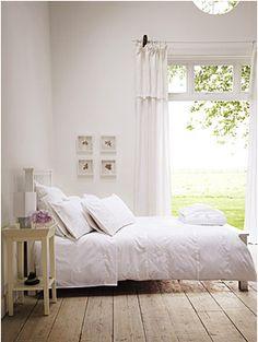 Gorgeous wide plank floors in this serene bedroom. #minimalist