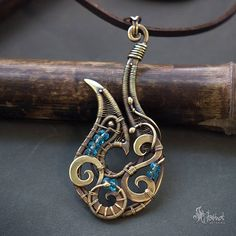 Tribal wire wrapped pendant // Tribal fish hook // Wire
