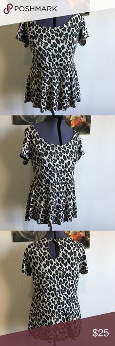 🐆Torrid Leopard Print Peplum Top Plus Size! 2 SO CUTE Knit peplum top in leopard print by Torrid. Has keyhole at back neck. A teeny too big for me and my dress form, it won't look as baggy and has a great pin up shape!  Torrid size 2 which is about a size 20 Torrid Tops Tees - Short Sleeve