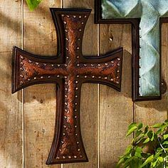 "TOOLED LEATHER CROSS  _  Beautiful and inspirational pieces of art for your walls. Dark tooled Chaparral colored leather or hand colored turquoise leather is layered onto a wood base. 16 1/2"" x 22""."