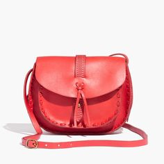 Artfully embossed leather and hand-stitched details give this timeless crossbody a true '70s feel, with roomy pockets on the front and back. Say hello to the take-it-everywhere bag that can handle all of your essentials.