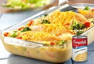 Cheesy Chicken  Rice Casserole - This one-dish wonder features moist, tender chicken breasts covered with melted Cheddar cheese, sitting on a bed of creamy rice and vegetables - it just doesnt get any better!