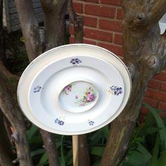 Yard art,  Do you suppose the dowel is glued?  Hmmmm.