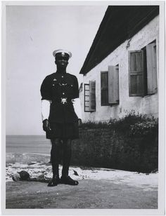 """Police officer standing outside a building,"" 1953 Ghana  by Richard Wright"