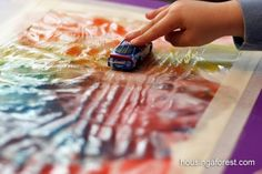 This, with a toy train:  2 ways your kids can use a plastic bag to fingerpaint without the mess | Offbeat Families