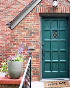 Tavern door by benjamin moore brick house curb appeal brick tudor green fro Green Front Doors, Painted Front Doors, Front Door Colors, Front Door Decor, Exterior Door Colors, Exterior Doors, Exterior Paint, Garage Door Design, Garage Doors