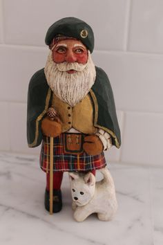 Scottish Santa with Westie. Original wood carving by Oregon artist, Jani Brown.  eBay seller:  janijims-at-home