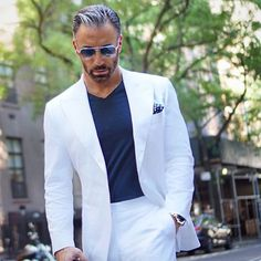 Not many can carry a white trouser n a white blazer... But this guy nails it