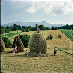 The Borca family, from the village of Breb, put finishing touches to one of the 40 or so haystacks they make each summer, Transylvania, Romania - by Rena Effendi Azerbaijani Champs, Ukraine, World Press Photo, The Farm, National Geographic Photographers, Lomography, Eastern Europe, Country Life, Albania