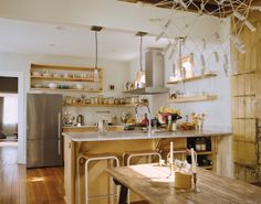 The trio of pendant lamps hanging above the counter came from Schoolhouse Electric Co. and were reworked by Peyton Avrett to fit the width of the header beam to which they are attached. The bar stools were gifted from a friend.  Photo by: Daniel Shea      Read more: http://www.dwell.com/slideshows/raise-high-the-roof-beams.html?slide=5=y=true##ixzz2F4zGUrml