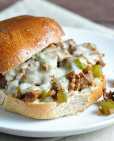 Philly Cheesesteak Burgers: Brown & drain ground chuck with onions & peppers (season w/salt, pepper, & worcestershire sauce). Add corn starch or flour to thicken. Add shredded cheese & country bobs steak sauce till melted. Serve on warm hamburger buns.