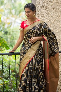 Black and red checked Kanakavalli inspired silk cotton saree with weave motifs