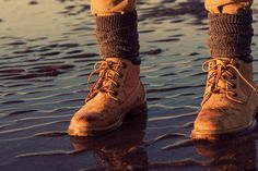 Young girl walking on a beach at low tide, feet detail, adventure concept - Young girl walking on a beach at low tide, feet detail, adventure concept