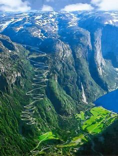 That road! And this fjord sparkles beneath soaring green cliffs. Lysefjorden, Norway