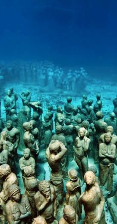 Behold the beauty of the Cancun Underwater Museum ff the coast of Isla de Mujeres in Cancun, Mexico.