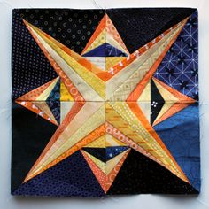 paper pieced star block from Wombat quilts
