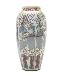 Richard Joyce for Pilkington Royal Lancastrian a Lustre Vase with Fish, circa 1915 painted with a band of fish swimming amid aquatic foliage, in silver and red on a blue ground 26cm high, artist monogram to base