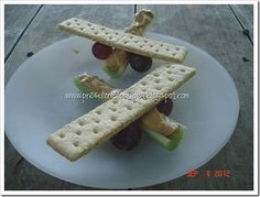 Edible Airplanes: Use a piece of celery generously filled with peanut butter for the airplane fuselage (body). Skewer a toothpick through the celery and poke a sliced carrot or grape on each side for wheels. Place a rectangle graham cracker on top (the peanut butter should hold it in place) to make the wings!