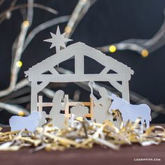 Enjoy this free paper cut nativity scene for your holiday decor. PDF and SVG included
