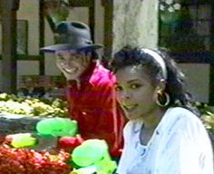 Janet & Michael having fun with Supersoakers :)