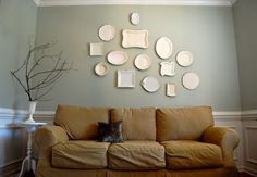 a couple of things i like... the plates, the wall color, the end table, the vase with the branches... it's all good. except that pillow on the couch. not so good.