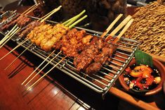 Sate Satu Meter from Harum Manis Restaurant, Jakarta - an assortment of skewered charcoal-grilled meat served on a meter-long wired tray.
