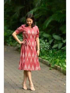 Red Ikat A line Tie up Dress from the house of Bluepin. Ikat Princess Cut Dress With Side Tie On Both Sides, Comes With Attached Cotton Lining. The lead time is days. Simple Gown Design, Simple Kurti Designs, Kurta Designs Women, Blouse Designs, Western Dresses For Women, Frock For Women, Tie Up Dress, Frock Dress, Salwar Dress
