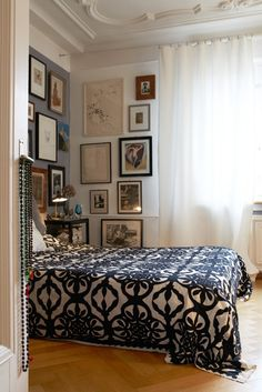 Bold patterned bedspread with fairly basic rest of the bedroom.