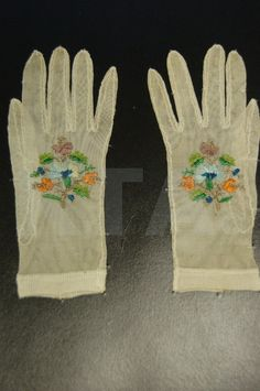 Knitted silk and embroidered lady's gloves circa 1820