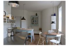 Det Skrå Køkkken. Love the trancher table. And the cupboard on the wall. And the lamps...